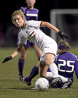 "Boston College forward Kristen Mewis (19) maintains control after University of Washington defender Molly Boyd (25) failed tackle. In overtime, Boston College defeated University of Washington, 1-0, in NCAA tournament ""Elite 8"" match at Newton Soccer Field, Newton, MA, on November 27, 2010."