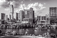 Aerial Austin Skyline BW - Aerial Austin skyline BW with the latest view along Lady Bird Lake with the hike and bike trail along the waters edge. This austin skyline done in black and white includes the new tallest building in the cityscape the Independent or Jingle as some call it, along with the Google new home, the Northshore condos, and of course the W building, and so many others its hard to name them all. You can just barely see the Austin 360 anymore as the new high rises have almost completely block its view from here. Austin is a fast growing city with all of it sky-scrapers built in the last ten year so it is has a modern cityscape in downtown. The city has also attracted many high tech companies to the city not to mention it is also the state capital and it is home to a major school the University of Texas. The city contines to draw tourist and people wanting to vist or live this lively modern city and its well know night life being the music capital of the world and it great life style. However with that said I must mention the draw back from the increase traffic which can be a complete night mare at time.