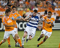 Houston Dynamo defender Bobby Boswell, Dynamo defender Geoff Cameron (20, and Dynamo midfielder Ricardo Clark (13) attempt to push FC Dallas forward Kenny Cooper (33) off the ball.  Houston Dynamo defeated FC Dallas 1-0 at Robertson Stadium in Houston, TX on May 9, 2009