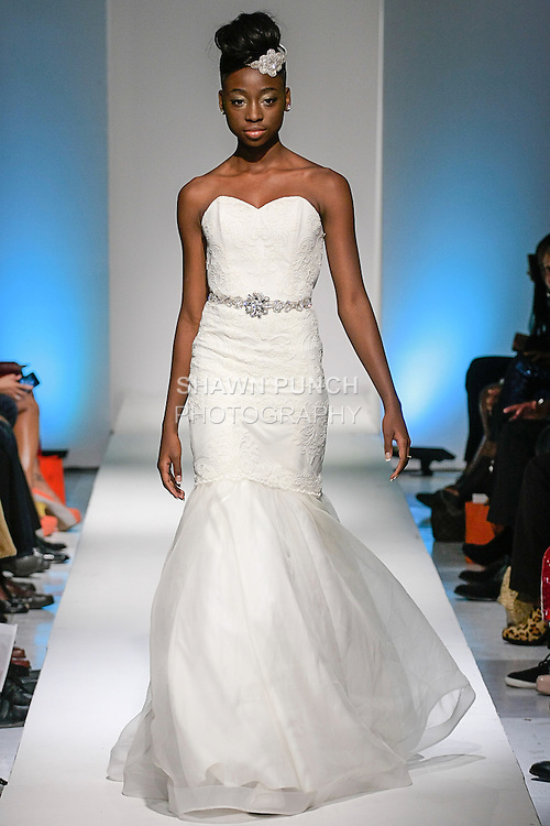 Model walks runway in a bridal dress from the Pantora by Andrea Fall 2013 collection by Andrea Pitter, during BK Fashion Weekend Spring Summer 2013.