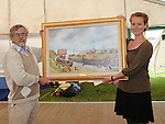 Acting Danish Ambassador Louise Holmsgaard is presented with a painting from local artist Micheal McKeown at the official opening of the Annagassan Viking Festival. Photo: Colin Bell/pressphotos.ie