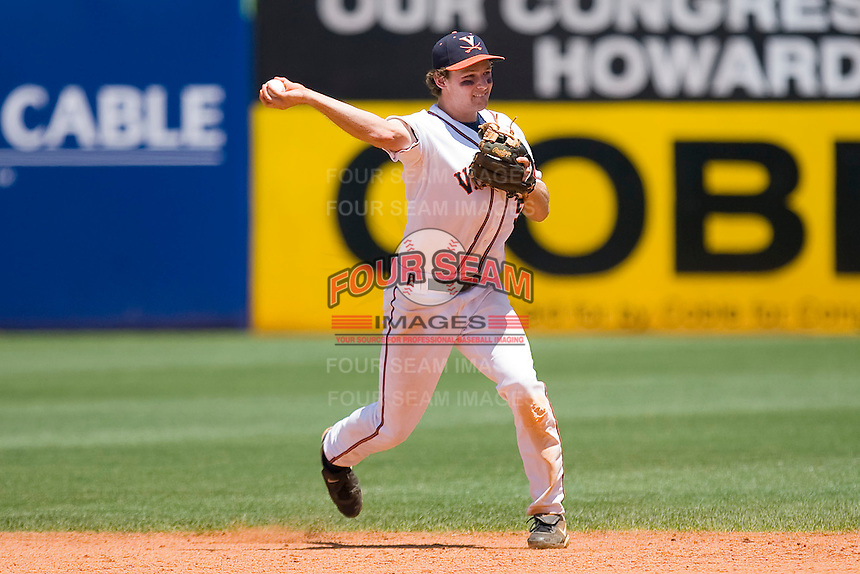 Second baseman Phil Gosselin #5 of the Virginia Cavaliers makes a throw to first base against the Boston College Eagles at the 2010 ACC Baseball Tournament at NewBridge Bank Park May 26, 2010, in Greensboro, North Carolina.  The Cavaliers defeated the Eagles 6-4.  Photo by Brian Westerholt / Four Seam Images