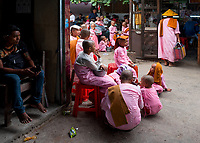 The Jade Market in Mandalay, Myanmar, Burma Buddhist Nuns collecting Alms