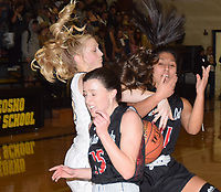 RICK PECK/SPECIAL TO MCDONALD COUNTY PRESS<br /> McDonald County's Ragan Wilson (15) and Rita Santillan (11) battle with Neosho's Olivia Hixson during the Lady Wildcats 46-42 win on Jan. 25 at Neosho High School.