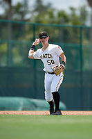 GCL Pirates third baseman Patrick Dorrian (50) throws to first base during a game against the GCL Tigers West on August 13, 2018 at Pirate City Complex in Bradenton, Florida.  GCL Tigers West defeated GCL Pirates 5-1.  (Mike Janes/Four Seam Images)