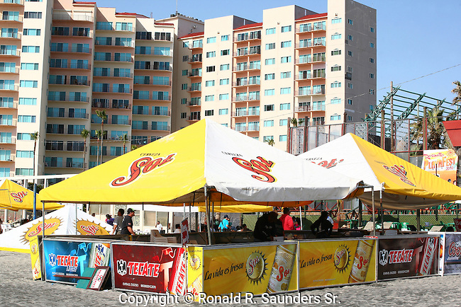 HI-RISE APARTMENTS ABOVE and Beer tent on ground