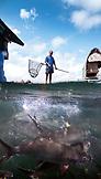 PHILIPPINES. Puerto Princessa, Fish Farm manager Ennesto Estrada, Santa Lucia Area