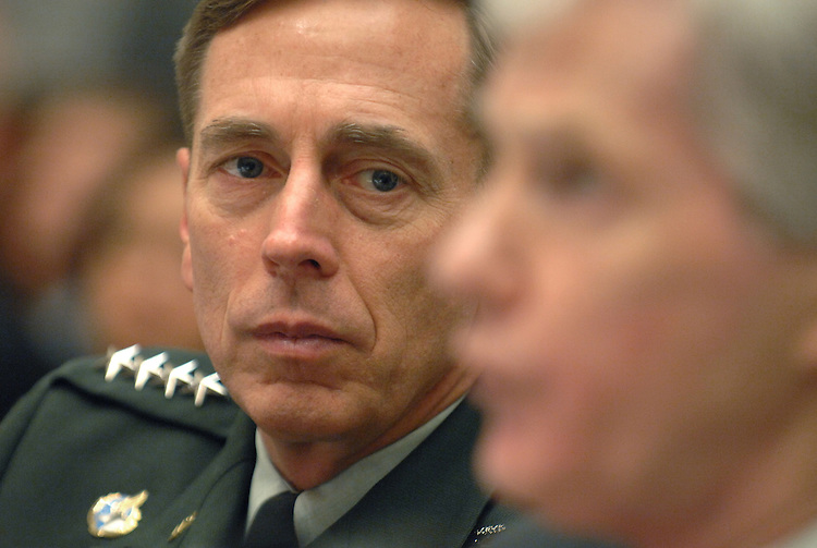 Gen. David Petraeus, left, listens to testimony from U.S ambassador to Iraq, Ryan Crocker, during a House Armed Services Committee on the Status of the war in Iraq.
