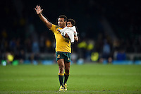 Will Genia of Australia waves to the crowd with his young child in hand after the match. Rugby World Cup Semi Final between Argentina v Australia on October 25, 2015 at Twickenham Stadium in London, England. Photo by: Patrick Khachfe / Onside Images