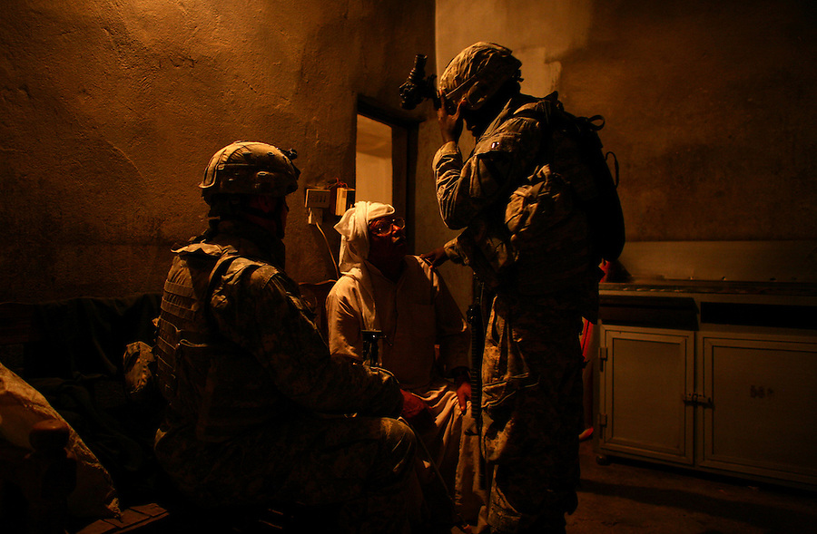 After being inserted by helicopter, soldiers from 1-12 Cavalry 3HBCT 1st Cavalry Division orient themselves and establish radio contact before moving on with an air assault mission looking for insurgent prison and training facilities in the countryside near the Diyala provincial capital, Baqubah, on Monday May 28, 2007.