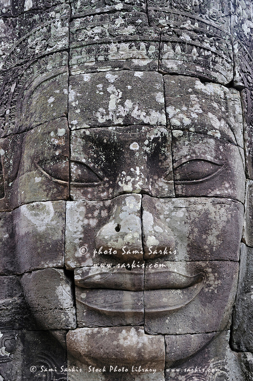 Carved stone face at Bayon Temple Angkor Wat, Siem Reap, Cambodia