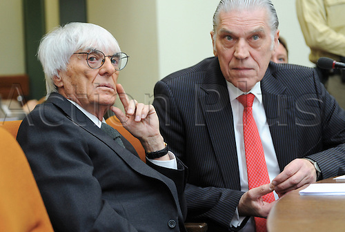 Bernie Ecclestone (L), CEO and president of F1's governing body, and his lawyer Sven Thomas wait for the beginning of another session of the trial against the former head of risk management at Bavarian bank BayernLB  Gribkowsky at the state court in Munich, Germany, 10 November 2011.  Former head of risk management at Bavarian bank BayernLB Gerhard Gribkowsky is charged with corruption, abuse of confidence and tax evasion, after overseeing the sale of BayernLB's commercial rights stake to private equity firm CVC Capital Partners in early 2006. Bernie Ecclestone has admitted to paying Gribkowsky a total of 44 million dollars in 2006 and 2007 from himself and his family holding company Bambino Trust on Monday, 09 November 2011.