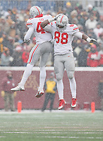Ohio State Buckeyes linebacker Darron Lee (43) and Ohio State Buckeyes defensive lineman Steve Miller (88) celebrate a sack in the second half at TCF Bank Stadium on November 15, 2014. (Chris Russell/Dispatch Photo)