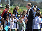 AUSTRALIA, Canberra : Britains Prince William speaks with children while visiting the National Arboretum, Canberra on April 24, 2014. Britain's Prince William, his wife Kate and their son Prince George are on a three-week tour of New Zealand and Australia. AFP PHOTO / Mark GRAHAM