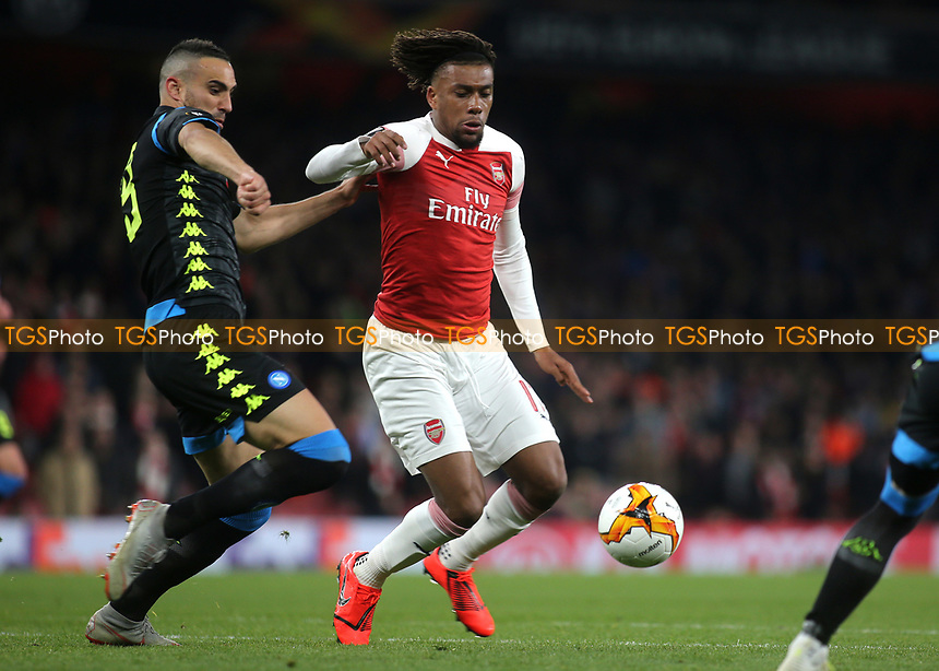 Alex Iwobi of Arsenal tries to shake off a challenge from Napoli's Allan during Arsenal vs Napoli, UEFA Europa League Football at the Emirates Stadium on 11th April 2019