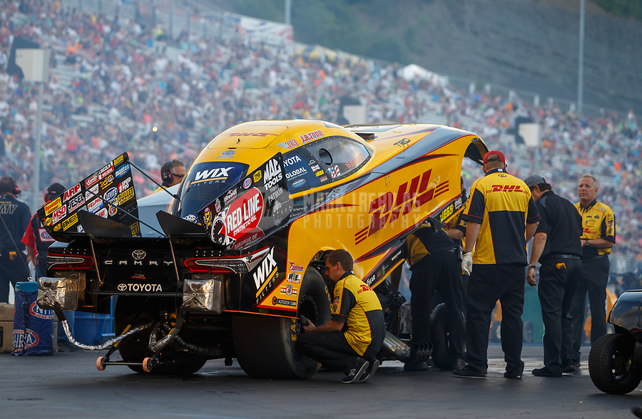 Jun 16, 2017; Bristol, TN, USA; Crew members for NHRA funny car driver J.R. Todd during qualifying for the Thunder Valley Nationals at Bristol Dragway. Mandatory Credit: Mark J. Rebilas-USA TODAY Sports