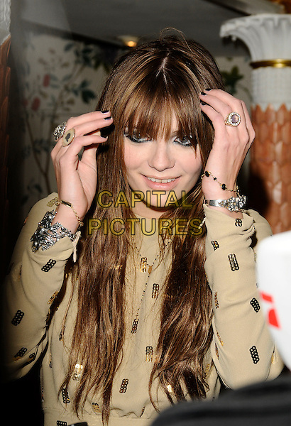 MISCHA BARTON.Fifi UK Fragrance Awards 2009, The Dorchester hotel, London, England..April 22nd 2009.half length gold yellow microphone long sleeves hands rings bracelets silver nail varnish polish funny face fringe bangs eyeliner sequins sequined.CAP/CAN.©Can Nguyen/Capital Pictures.
