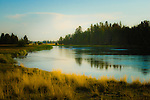 Sun setting on the Deschutes River, Sunriver,  Oregon.