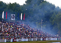 May 31, 2014; Englishtown, NJ, USA; Smoke from a burnout goes over the grandstands of NHRA fans during qualifying for the Summernationals at Raceway Park. Mandatory Credit: Mark J. Rebilas-