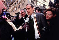 (011222-SWR08.jpg) New York, NY -- Herman Badillo, New York City Mayor Rudy Giuliani, with Press Secretary Cristyne Lategamo at his side, speaks to the medisa before marching in the Saint Patrick's Day Parade.