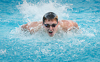 Austin Lashley '18 in the men's 100 yard butterfly stroke. The Occidental College swim team competes against Lewis & Clark College and Westminster College in Taylor Pool on Jan. 6, 2015. (Photo by Marc Campos, Occidental College Photographer)