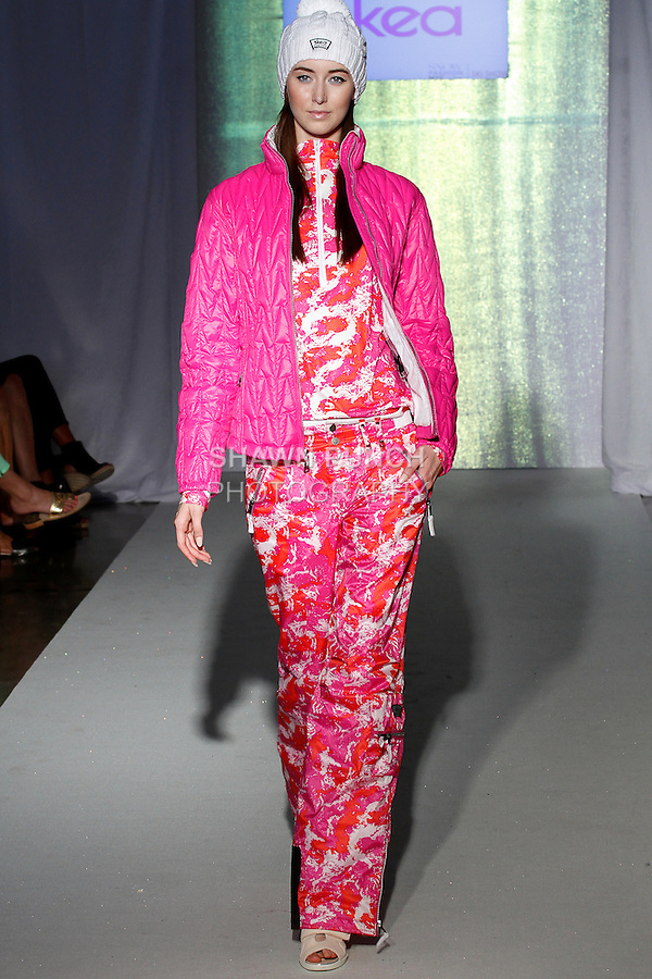 Model walks runway in an outfit from the Skea collection, during the SNOW Fashion NYC - Ski fashion show, June 11, 2013.