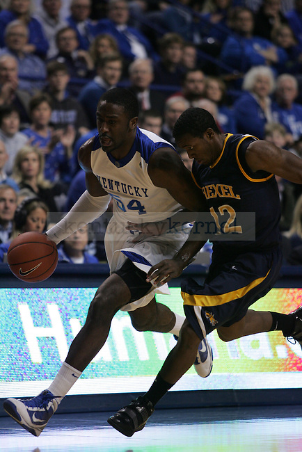 Junior forward Patrick Patterson fights off Drexel's Jamie Harris during the UK men's basketball against Drexel at Rupp Arena on Monday, Dec. 21, 2009. Photo by Adam Wolffbrandt | Staff
