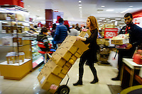 A worker carries boxes with merchandise during Black Friday sales events in Jersey City, NJ.  11/27/2015. Eduardo MunozAlvarez/VIEWpress