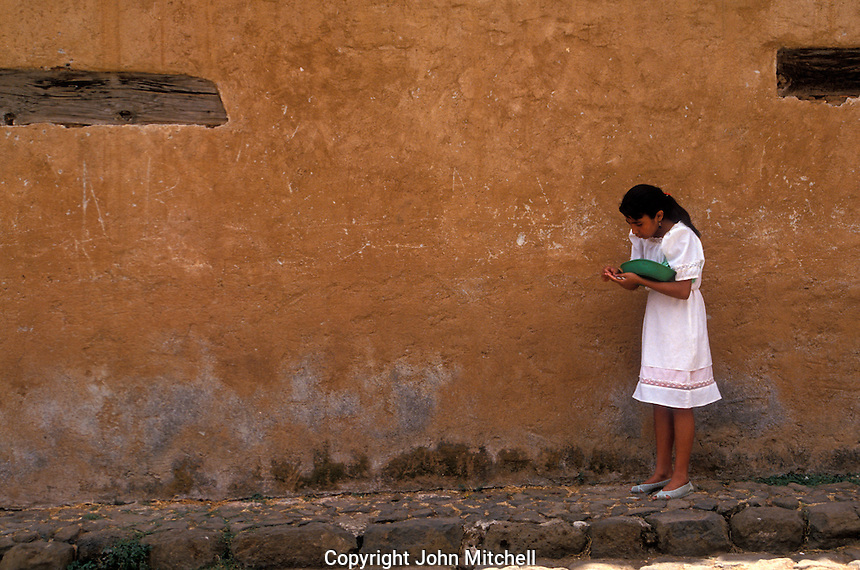 Girl counting change on a street in Patzcuaro, Michoacan, Mexico