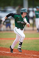 Dartmouth Big Green second baseman Sean Sullivan (4) runs to first base during a game against the Southern Maine Huskies on March 23, 2017 at Lake Myrtle Park in Auburndale, Florida.  Dartmouth defeated Southern Maine 9-1.  (Mike Janes/Four Seam Images)