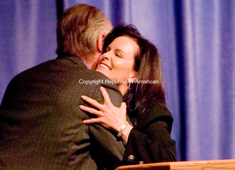 WATERBURY, CT. 19 April 2007-041907SV03--Bruce Carlson gives Denise Brown a hug before she speaks at the 11th annual Melanie Ilene Rieger Memorial Conference held at Department of Correction Maloney Center for Training and Staff Development in Cheshire Thursday. Brown is the sister of Nicole Brown Simpson, the murdered ex-wife of O.J. Simpson.<br /> Steven Valenti Republican-American