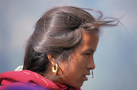 In the high altitude villages of north central Nepal, in villages which can be as much as two days' hard walking from any road, many women wear elaborate gold nose-rings as well as ear-rings.