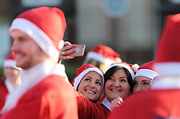 Pictured: Runners in Santa Claus fancy dress take a selfie in this year's run in Aberavon, Wales, UK. Saturday 16 December 2017<br /> Re: 500 people have taken part in Run4All Santa 5km Run on Aberavon Promenade near Port Talbot, Wales, UK.