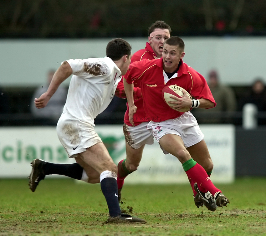 Photo. Richard Lane. .Wales U21 v England U21 at Sardis Road, Pontypridd, Wales. 2/2/2001.Owian Ashman breaks from defence.