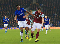 26th December 2019; Goodison Park, Liverpool, Merseyside, England; English Premier League Football, Everton versus Burnley; Yerry Mina of Everton competes for  the ball with James Tarkowski of Burnley - Strictly Editorial Use Only. No use with unauthorized audio, video, data, fixture lists, club/league logos or 'live' services. Online in-match use limited to 120 images, no video emulation. No use in betting, games or single club/league/player publications