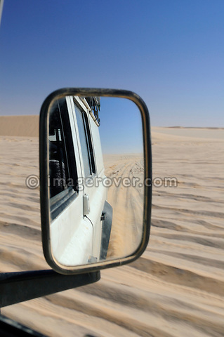 Africa, Mauritania, Sahara Desert, nr. Nouadhibou. Land Rover Defender TD5 Station Wagon crossing a sandy plain on the coastal piste from Nouakchott to Nouadhibou through the nature reserve Parc National du Banc D'Arguin in Mauritania. --- RELEASES AVAILABLE! Automotive trademarks are the property of the trademark holder, authorization may be needed for some uses.