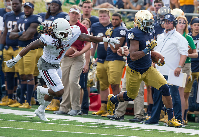 Sept. 26, 2015; Running back C.J. Prosise breaks away for a 57-yard touchdown in the first quarter against the University of Massachusetts at Notre Dame Stadium. (Photo by Barbara Johnston/University of Notre Dame)
