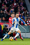 Sergio Garcia de la Fuente, S Garcia, of RCD Espanyol (R) in action against Angel Correa of Atletico de Madrid during the La Liga 2018-19 match between Atletico de Madrid and RCD Espanyol at Wanda Metropolitano on December 22 2018 in Madrid, Spain. Photo by Diego Souto / Power Sport Images