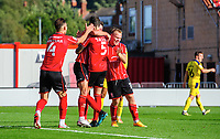 Lincoln City's Adam Jackson (number five) celebrates scoring his side's second goal with team-mates, from left, Lewis Montsma, Tom Hopper and Anthony Scully<br /> <br /> Photographer Chris Vaughan/CameraSport<br /> <br /> The EFL Sky Bet League One - Saturday 12th September 2020 - Lincoln City v Oxford United - LNER Stadium - Lincoln<br /> <br /> World Copyright © 2020 CameraSport. All rights reserved. 43 Linden Ave. Countesthorpe. Leicester. England. LE8 5PG - Tel: +44 (0) 116 277 4147 - admin@camerasport.com - www.camerasport.com - Lincoln City v Oxford United