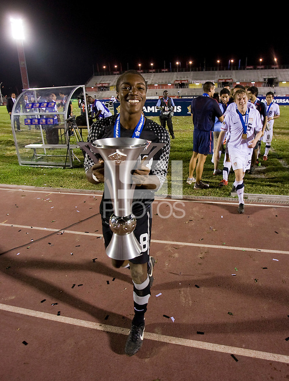 Kendall McIntosh (18) of the United States holds the trophy after the finals of the CONCACAF Men's Under 17 Championship at Catherine Hall Stadium in Montego Bay, Jamaica. The United States defeated Canada, 3-0, in overtime