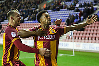 Substitute Tyrell Robinson of Bradford City celebrates  scoring a last minute winner with team mate Charlie Wyke during the Sky Bet League 1 match between Wigan Athletic and Bradford City at the DW Stadium, Wigan, England on 18 November 2017. Photo by Thomas Gadd.