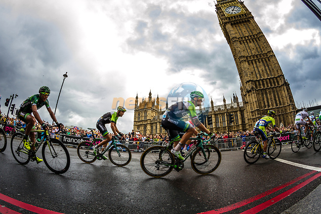 The peleton including Lars Boom (NED) Belkin pass the Houses of Parliment Westminster near the end of Stage 3 of the 2014 Tour de France running 155km from Cambridge to London. 7th July 2014.<br /> Picture:Thomas Van Bracht/Peleton Photos/www.newsfile.ie