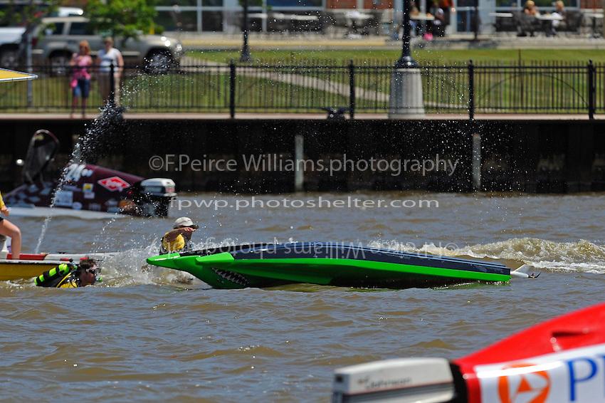 Frame 10: Jason Nelson, (#18) flips over in turn 2. (SST-45 class)