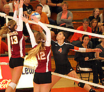 SIOUX FALLS, SD - OCTOBER 1:  Tagyn Larson #13 and Elizabeth Fiegen #12 and from Roosevelt double team for a block on the tip from Caryn Hazard #4 from Washington in the third game of their match Tuesday night at Washington. (Photo by Dave Eggen/Inertia)