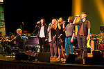 Pink Martini with Thomas Lauderdale on piano rehearsing with the Oregon Symphony with the von Trapps at the Arlene Schnitzer concert hall in Portland, Oregon.  In the center in black is Pink Martini singer China Forbes.