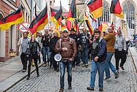 """Rechte demonstrieren in Bautzen gegen Fluechtlinge.<br /> Am Sonntag den 18. September 2016 versammelten sich im saechsischen Bautzen ca. 120 Rechte zu einem Kundgebung mit anschliessender Demonstration um gegen Fluechtlinge zu demonstrieren. Sie riefen Parolen gegen Fluechtlinge und gegen Angela Merkel und beschimpften Medienvertreter als """"Volksverraeter"""".<br /> Nach Aussagen von Anwohnern waren nur etwa 15 Teilnehmer aus Bautzen. Bautzener Rechtsextreme hatten zuvor aufgerufen, sich vorerst nicht an Demonstrationen zu beteiligen, bis ein von ihnen an die Stadtverwaltung gestelltes Ultimatum, zu Loesung der Fluechtlingsfrage verstrichen ist.<br /> 2. von Links im Bild mit Megaphon: Ester Seitz aus Bayern, Anmelderin der Veranstaltung.<br /> 18.9.2016, Bautzen/Sachsen<br /> Copyright: Christian-Ditsch.de<br /> [Inhaltsveraendernde Manipulation des Fotos nur nach ausdruecklicher Genehmigung des Fotografen. Vereinbarungen ueber Abtretung von Persoenlichkeitsrechten/Model Release der abgebildeten Person/Personen liegen nicht vor. NO MODEL RELEASE! Nur fuer Redaktionelle Zwecke. Don't publish without copyright Christian-Ditsch.de, Veroeffentlichung nur mit Fotografennennung, sowie gegen Honorar, MwSt. und Beleg. Konto: I N G - D i B a, IBAN DE58500105175400192269, BIC INGDDEFFXXX, Kontakt: post@christian-ditsch.de<br /> Bei der Bearbeitung der Dateiinformationen darf die Urheberkennzeichnung in den EXIF- und  IPTC-Daten nicht entfernt werden, diese sind in digitalen Medien nach §95c UrhG rechtlich geschuetzt. Der Urhebervermerk wird gemaess §13 UrhG verlangt.]"""