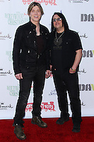 HOLLYWOOD, CA - DECEMBER 01: John Rzeznik, Robby Takac of Goo Goo Dolls arriving at the 82nd Annual Hollywood Christmas Parade held at Hollywood Boulevard on December 1, 2013 in Hollywood, California. (Photo by Xavier Collin/Celebrity Monitor)