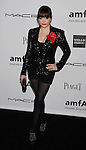 LOS ANGELES, CA - OCTOBER 11: Rose McGowan arrives at the amfAR 3rd Annual Inspiration Gala at Milk Studios on October 11, 2012 in Los Angeles, California.