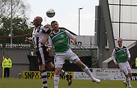 Jim Goodwin (left) and Roy Donovan challenge in the St Mirren v Hibernian Clydesdale Bank Scottish Premier League match played at St Mirren Park, Paisley on 29.4.12.