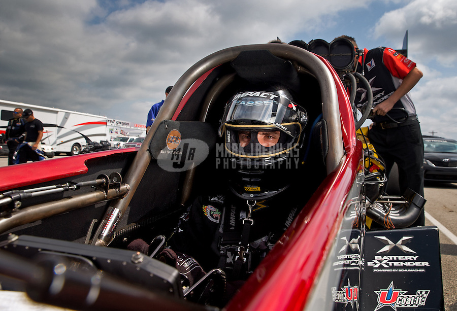 Sept. 1, 2013; Clermont, IN, USA: NHRA top fuel dragster driver Spencer Massey during qualifying for the US Nationals at Lucas Oil Raceway. Mandatory Credit: Mark J. Rebilas-